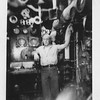 P00065 Sailor in work uniform in boiler room