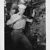 P00124 Sailor in work uniform in boiler room