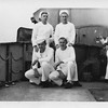 P00146 Four sailors in dress whites on main deck