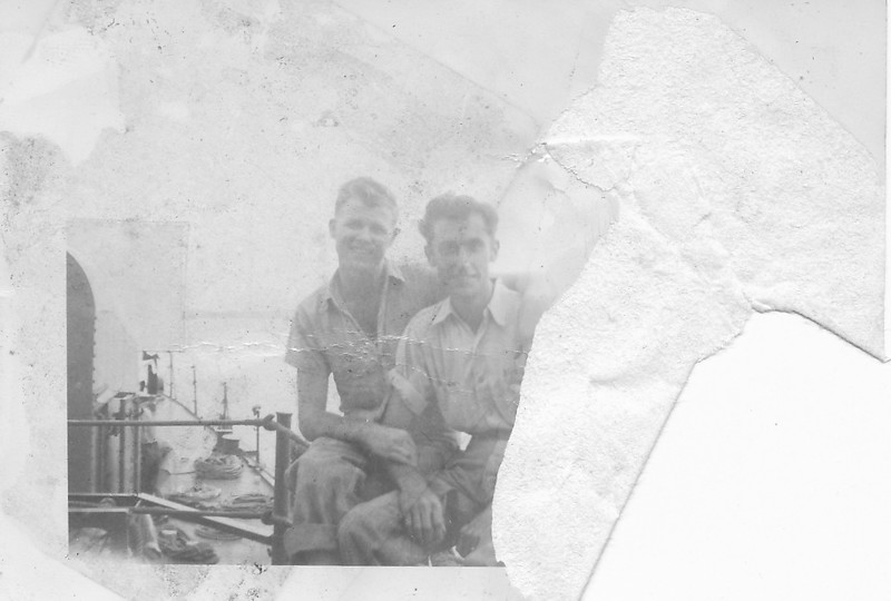 P00143  Two sailors in work uniform sitting on rail