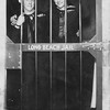 "P00069 Two sailors in dress blues in ""Long Beach Jail"""