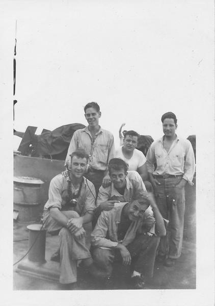 P00147 Six sailors in work uniform on main deck