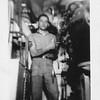 P00130 Sailor in work uniform in Main Engine Room