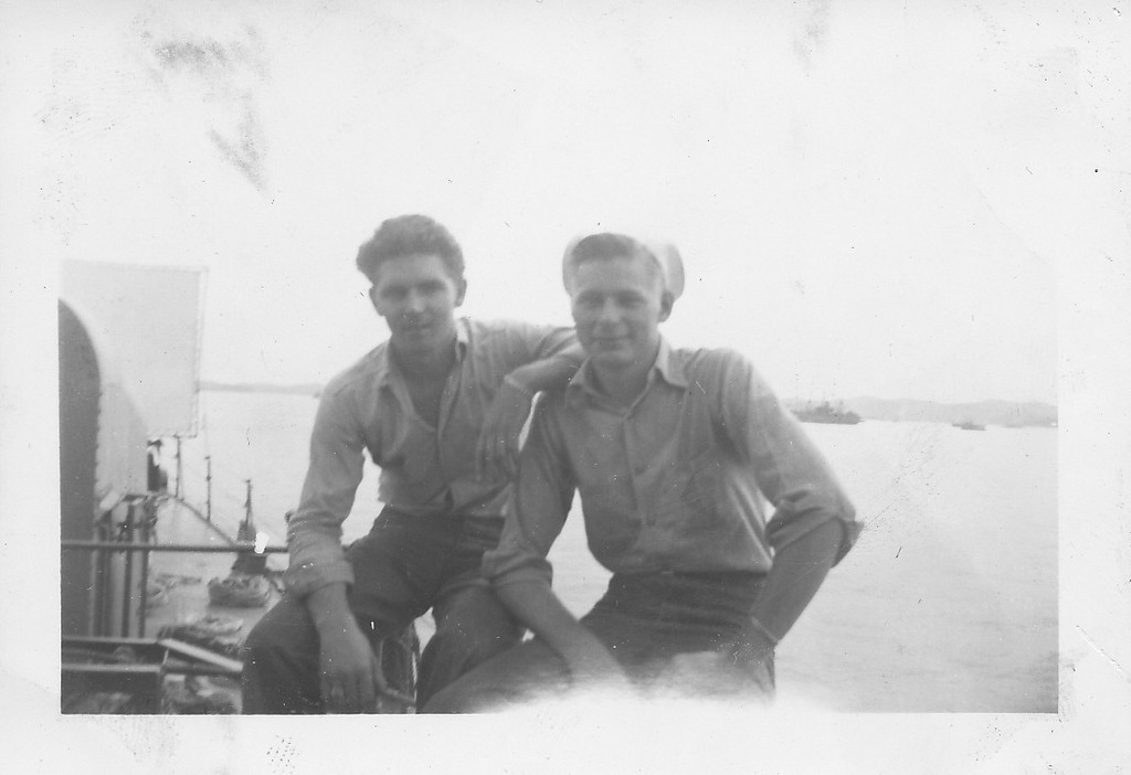 P00141 Two sailors in work uniform sitting on rail
