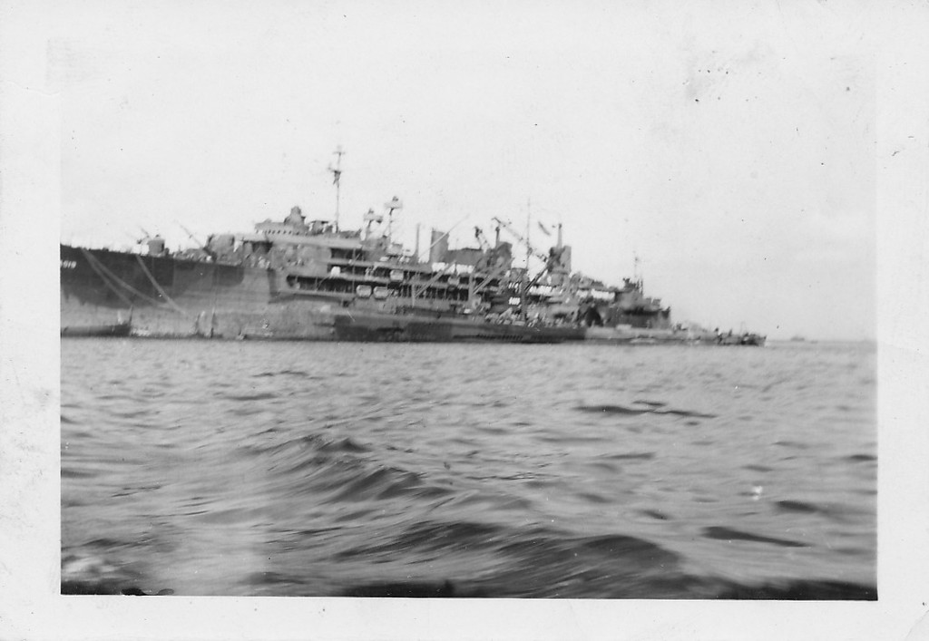 P00158 Taylor approaching pier (probably Japan, 1945)