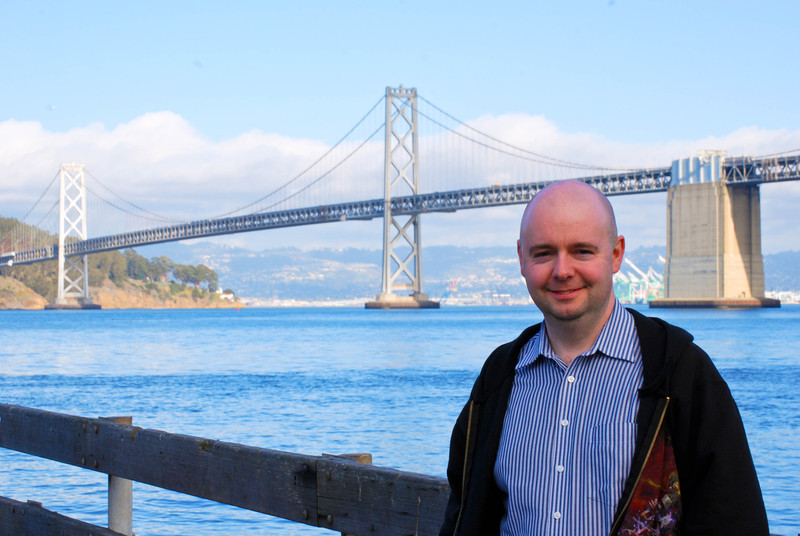 Stu standing in front of Bay Bridge at the Port of San Francisco