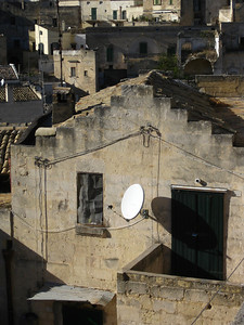 Juxtaposition of ancient home and satellite dish is common