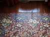 An interesting faux-Persian rug, which appears to be made of a thick canvas with the pattern painted on.