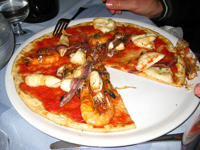Pizza de mare - no cheese, just tomato sauce and a lot of seafood.  The unpeeled shrimp were a bit of a pain though