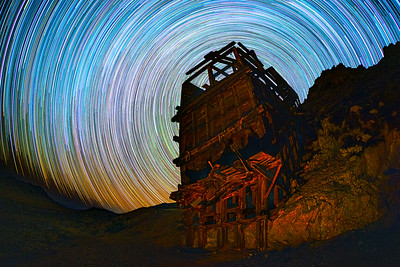 Star Trails Behind a Large Old Wooden Ore Bin