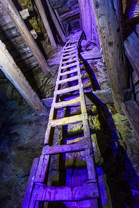 Flooded Gold Mine Exploration. Tall ladder going way up.