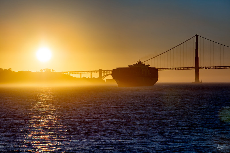 Sunset on a lonesome cargo ship