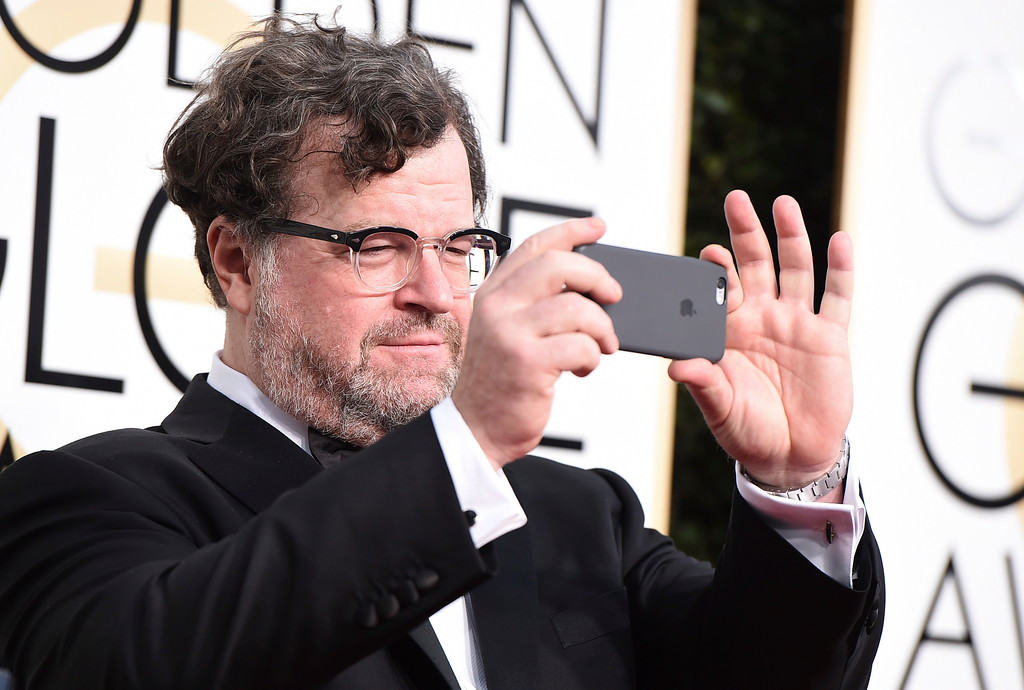 . Kenneth Lonergan holds his cell phone as he arrives at the 74th annual Golden Globe Awards at the Beverly Hilton Hotel on Sunday, Jan. 8, 2017, in Beverly Hills, Calif. (Photo by Jordan Strauss/Invision/AP)