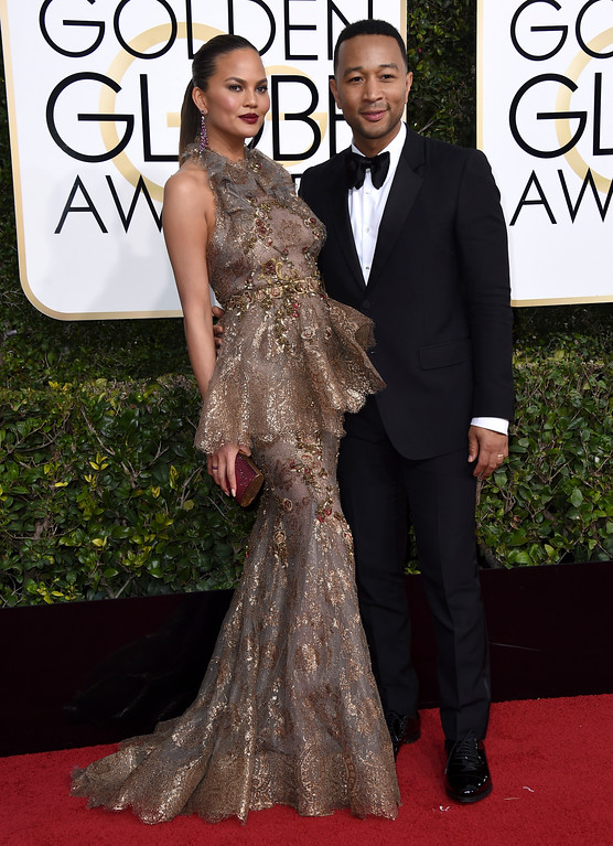 . Chrissy Teigen, left, and John Legend arrive at the 74th annual Golden Globe Awards at the Beverly Hilton Hotel on Sunday, Jan. 8, 2017, in Beverly Hills, Calif. (Photo by Jordan Strauss/Invision/AP)