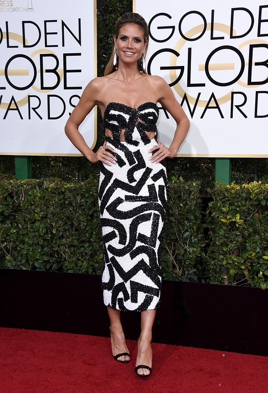 . Heidi Klum arrives at the 74th annual Golden Globe Awards at the Beverly Hilton Hotel on Sunday, Jan. 8, 2017, in Beverly Hills, Calif. (Photo by Jordan Strauss/Invision/AP)