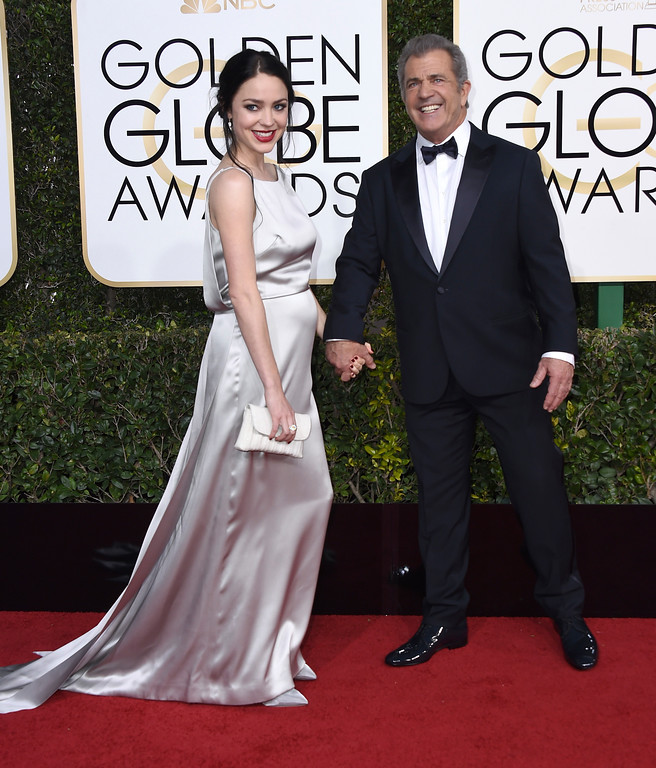 . Rosalind Ross, left, and Mel Gibson arrive at the 74th annual Golden Globe Awards at the Beverly Hilton Hotel on Sunday, Jan. 8, 2017, in Beverly Hills, Calif. (Photo by Jordan Strauss/Invision/AP)