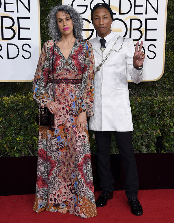 . Mimi Valdes, left, and Pharrell Williams arrive at the 74th annual Golden Globe Awards at the Beverly Hilton Hotel on Sunday, Jan. 8, 2017, in Beverly Hills, Calif. (Photo by Jordan Strauss/Invision/AP)
