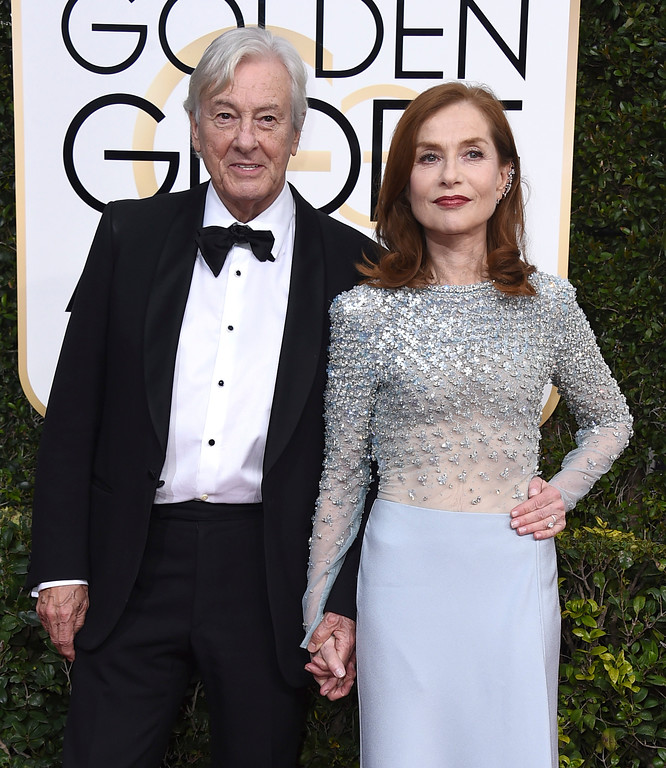 . Paul Verhoeven, left, and Isabelle Huppert arrive at the 74th annual Golden Globe Awards at the Beverly Hilton Hotel on Sunday, Jan. 8, 2017, in Beverly Hills, Calif. (Photo by Jordan Strauss/Invision/AP)