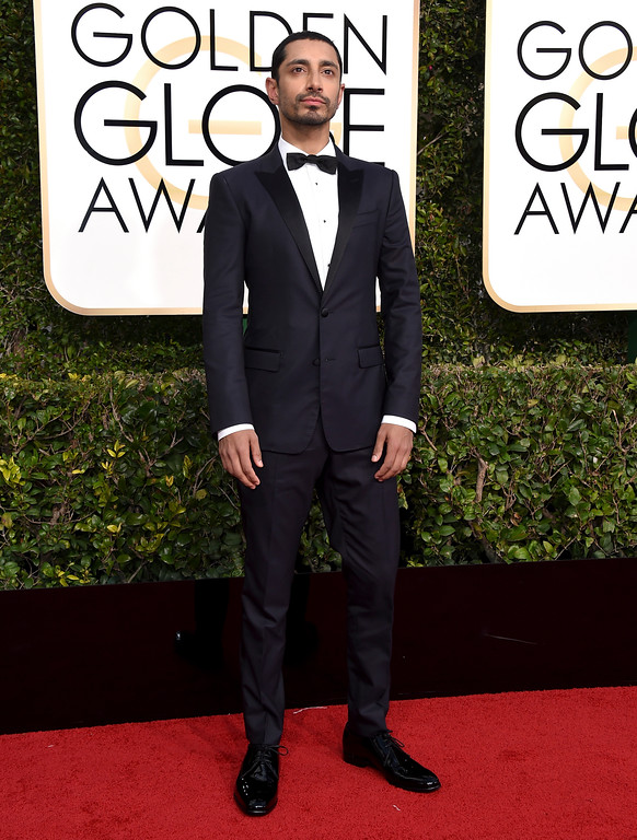 . Riz Ahmed arrives at the 74th annual Golden Globe Awards at the Beverly Hilton Hotel on Sunday, Jan. 8, 2017, in Beverly Hills, Calif. (Photo by Jordan Strauss/Invision/AP)