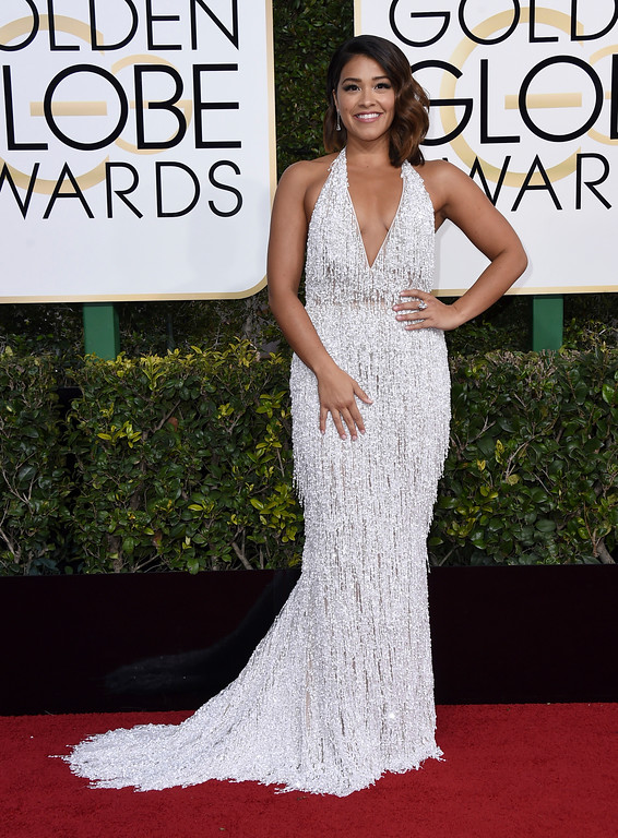 . Gina Rodriguez arrives at the 74th annual Golden Globe Awards at the Beverly Hilton Hotel on Sunday, Jan. 8, 2017, in Beverly Hills, Calif. (Photo by Jordan Strauss/Invision/AP)
