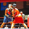 Alexis Bolduc (red trunks), of Hudson, N.H., battles Alyssa Kinahan-Dundas (blue trunks), of Boston, during Thursday's Golden Gloves match at Lowell Memorial Auditorium. (Sun / John Corneau)