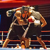 Gabriel Morales (black trunks) of Dracut, battles Kirby Espinal (grey trunks), of Dorchester, during Thursday's Golden Gloves match at Lowell Memorial Auditorium. (Sun / John Corneau)