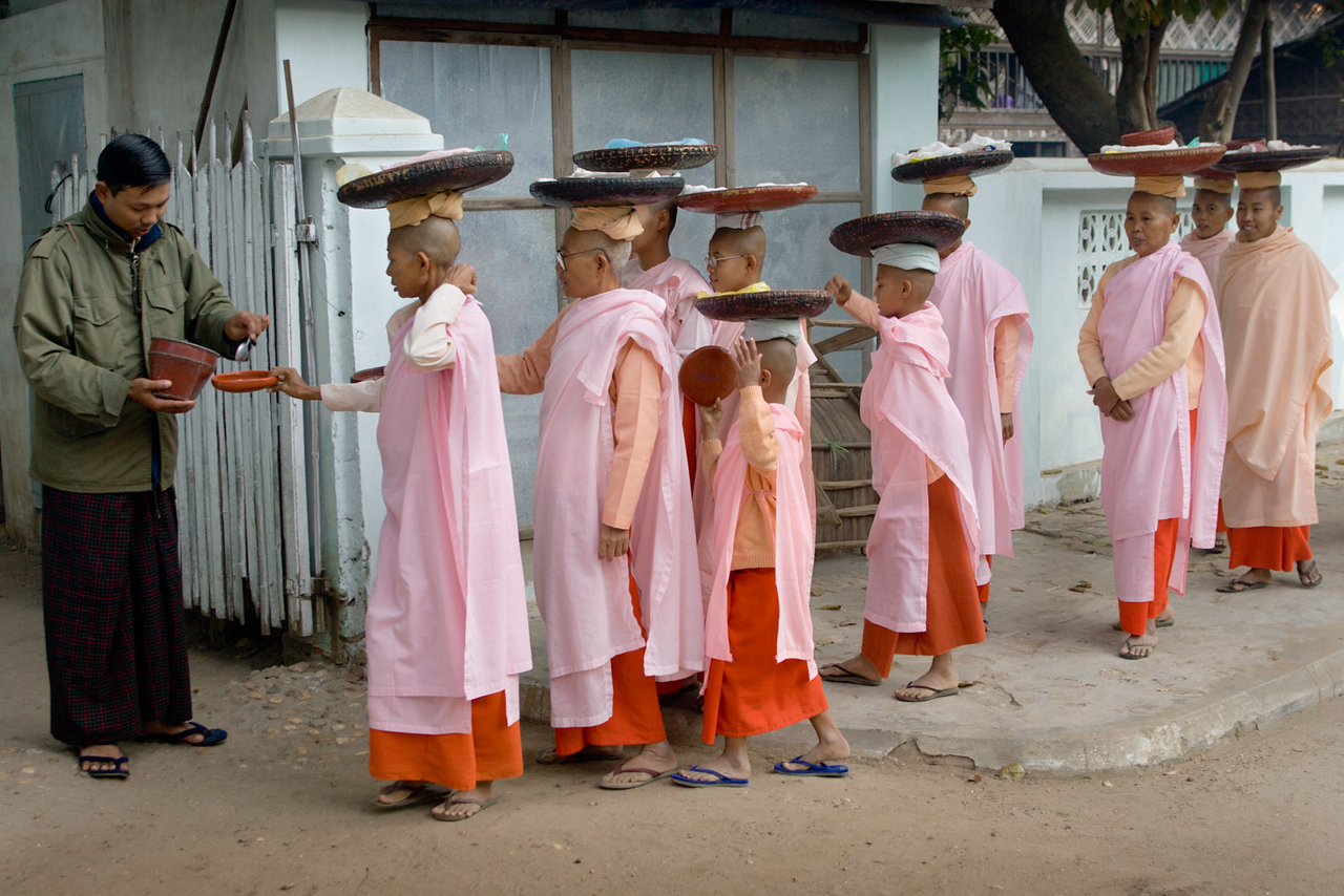 Nuns are offered food in the morning. Nyaung U, Bagan.