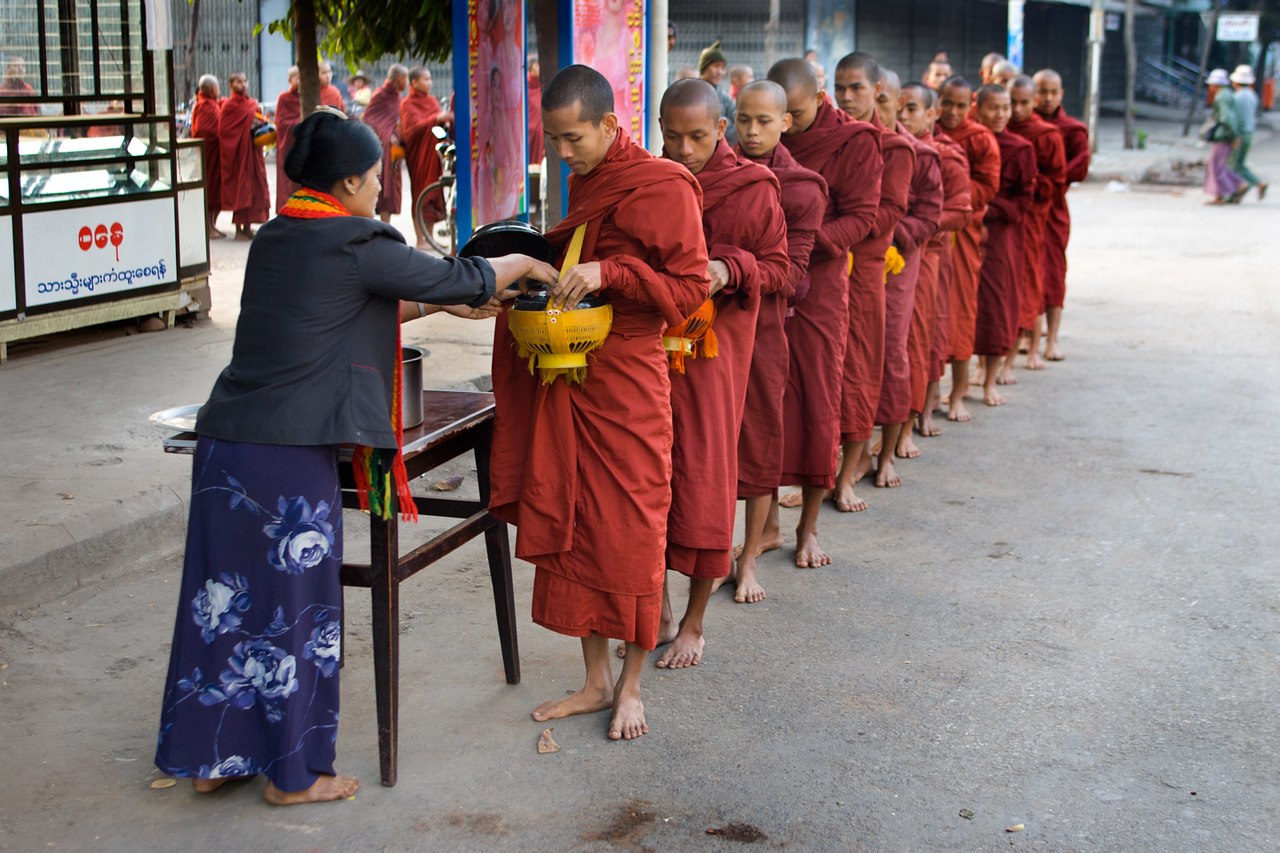 Monks are offered food in morning. Mandalay.