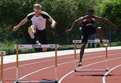 Roadrunner teammates Tristan Barnard, left, and Henry Rowe, right, leap in the 400-meter hurdles as Butte College hosts the Golden Valley Track and Field Championships at the college's stadium Friday, April 28, 2017, in Butte Valley, California. (Dan Reidel -- Enterprise-Record)