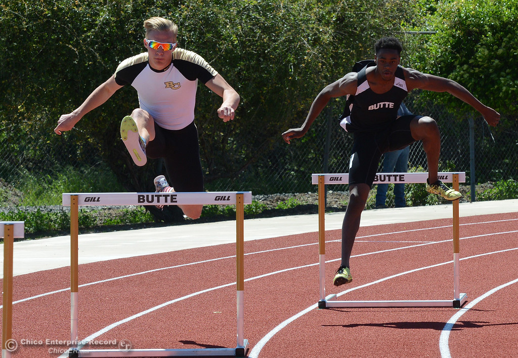 . Roadrunner teammates Tristan Barnard, left, and Henry Rowe, right, leap in the 400-meter hurdles as Butte College hosts the Golden Valley Track and Field Championships at the college\'s stadium Friday, April 28, 2017, in Butte Valley, California. (Dan Reidel -- Enterprise-Record)