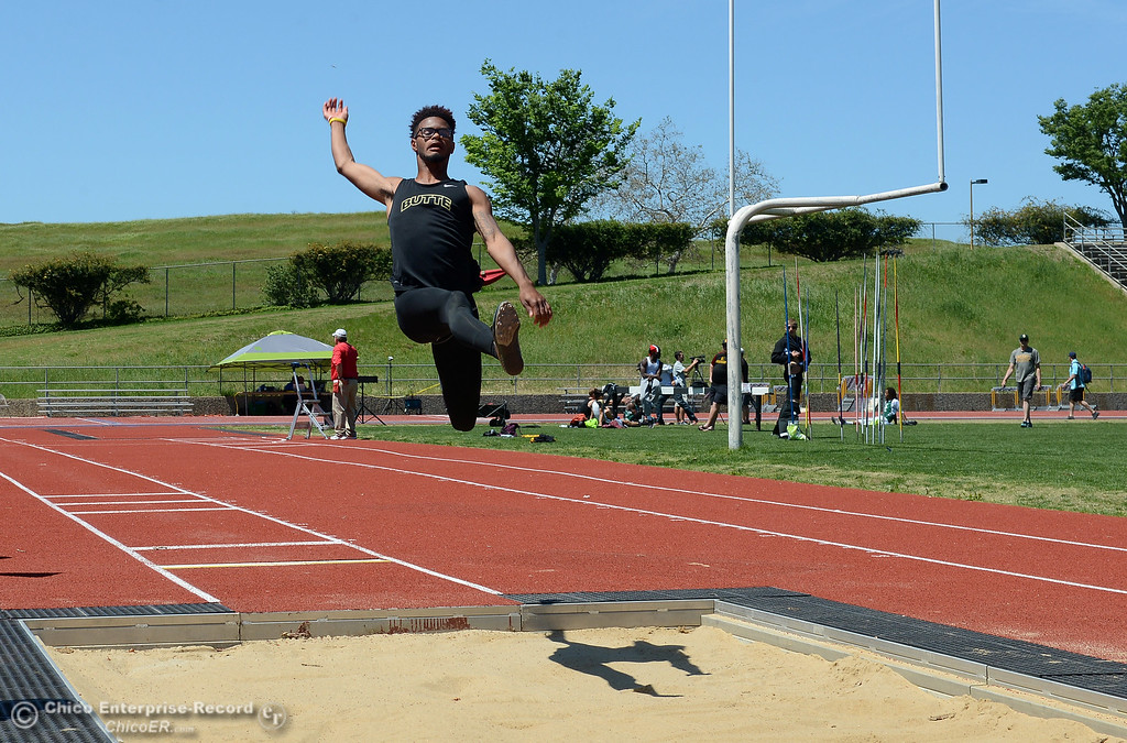 . Sophomore Dwayne Fontenette leaps in the long jump as Butte College hosts the Golden Valley Track and Field Championships at the college\'s stadium Friday, April 28, 2017, in Butte Valley, California. (Dan Reidel -- Enterprise-Record)