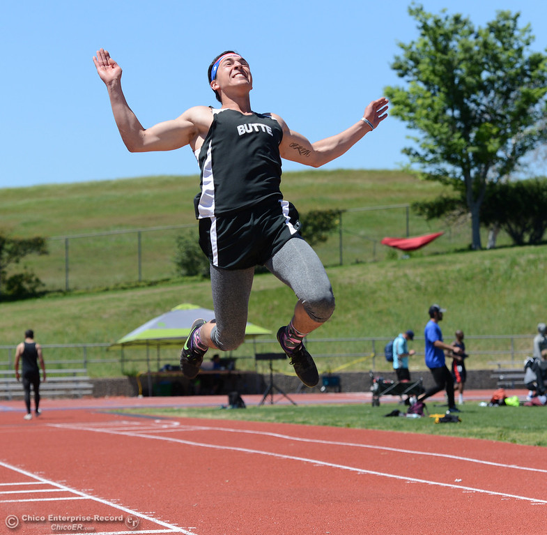 . Stephen Pena leaps high in the long jump as Butte College hosts the Golden Valley Track and Field Championships at the college\'s stadium Friday, April 28, 2017, in Butte Valley, California. (Dan Reidel -- Enterprise-Record)