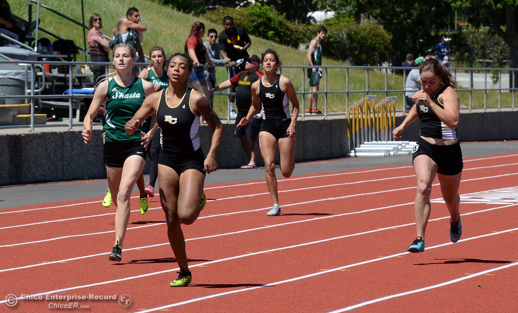 . Butte College\'s Mykisha Abrams, second from left, leads the 200-meter run as Butte College hosts the Golden Valley Track and Field Championships at the college\'s stadium Friday, April 28, 2017, in Butte Valley, California. Abrams won the race and also won the 100-meter dash. (Dan Reidel -- Enterprise-Record)