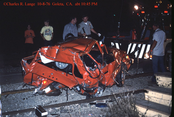 This smashed car, in front of the Goleta Depot, was struck at night by a westbound Pacific Railroad Society special after the car became hung up on the tracks at the Kellogg Ave. grade crossing. Luckily no one was in the car when it was struck. Charles Lange photograph.