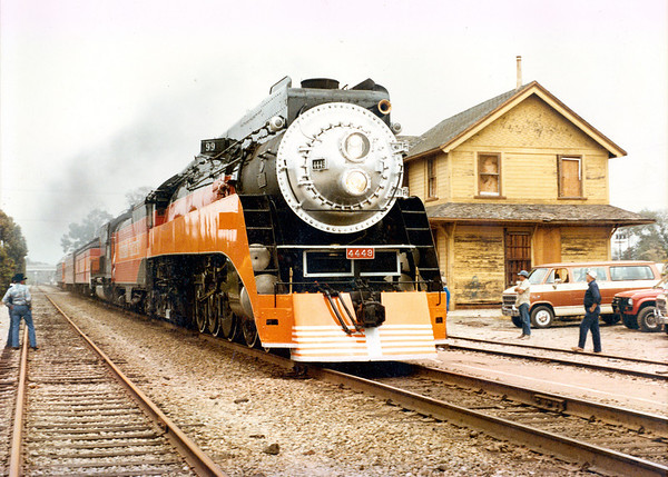 Southern Pacific Daylight locomotive No. 4449 passes a closed Goleta Depot on May 13, 1981. This train was returning from the City of Los Angeles Bicentennial celebration, after attending the 1981 Sacramento Railfair.  The consist included No. 4449, SP 7364, a baggage car, a crew car, a bay window caboose and a business car. Museum Acc. No. 2006.01.01.