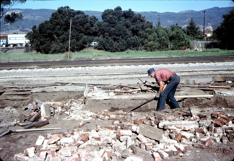 Eugene Allen salvages foundation bricks from Goleta Depot site, Nov. 19, 1981.