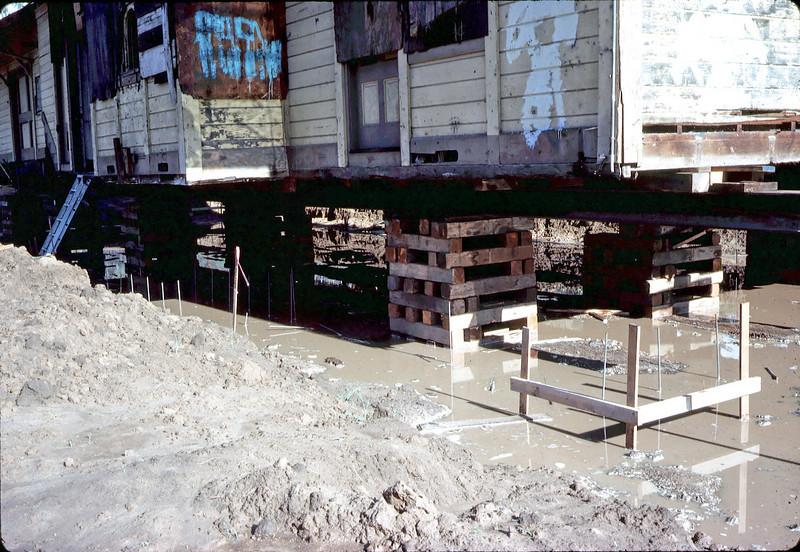 Rain water accumulates under depot, 11/28/1981. acc2005.001.0122