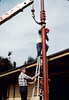 Gene Allen supervises as Specialty Crane & Rigging crew disconnect crane from train-order pole, ca. 11/1/1983. acc2005.001.0431