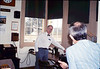 Volunteer agent John Starr shares the Freight Office with visitors, 10/1988. acc2005.001.1003