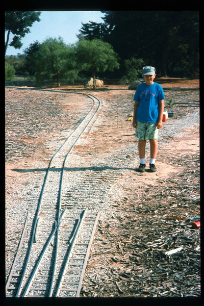 Austin Beede works on miniature-train expansion which will add 600 feet to route, Summer 1994. acc2005.001.2011