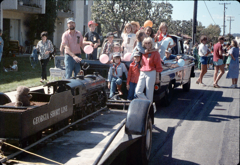 Museum entry in 1986 Goleta Valley Days Parade. Phyllis Olsen, Bill McNally & children from La Patera Elementary School. acc2005.001.0648