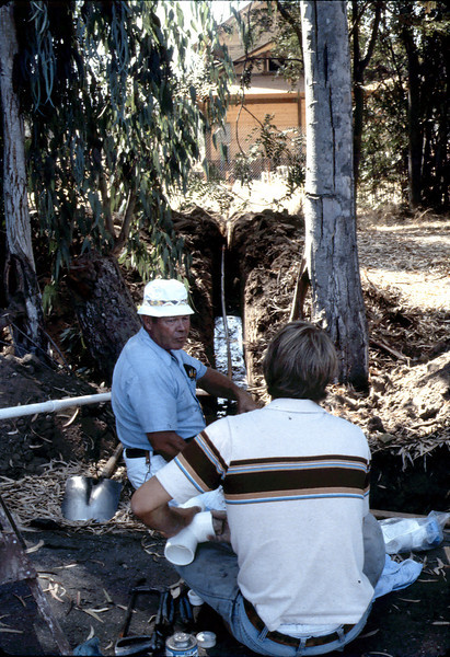 Bob Hiestand installs new water line, 8/1982. acc2005.001.0279