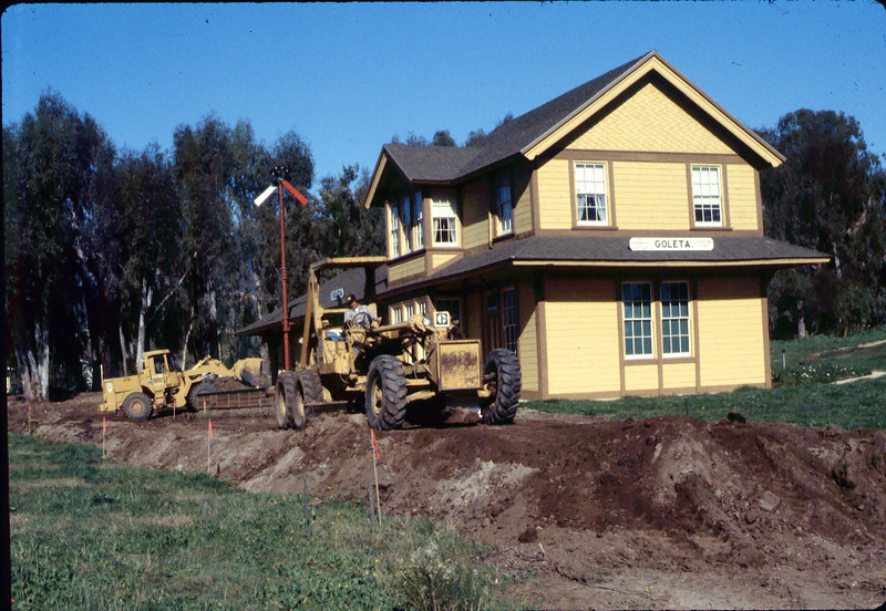Banner Construction crew grades in preparation for standard-gauge track construction in front of Goleta Depot, 1/1985. acc2005.001.0465A