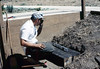 Ralph Moore builds steps out of railroad ties, 8/1983. acc2005.001.0391