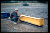 County SWAP worker paints miniature-train passenger cars, 1995. acc2005.001.2068