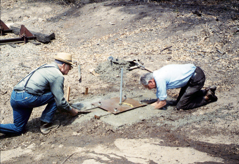 Pouring the slab for the wig-wag signal (Gene Allen and Al Volkman), 5/1989. acc2005.001.1159