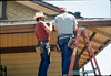 M&M Construction installs new redwood gutters, 5/1988. acc2005.001.0972