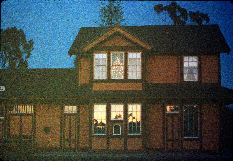 Goleta Depot front exterior with Christmas tree in upstairs bay, 12/1988. acc2005.001.1028