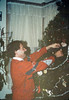 John Strickley helps decorate the Goleta Depot Christmas tree, 12/1987. acc2005.001.0885