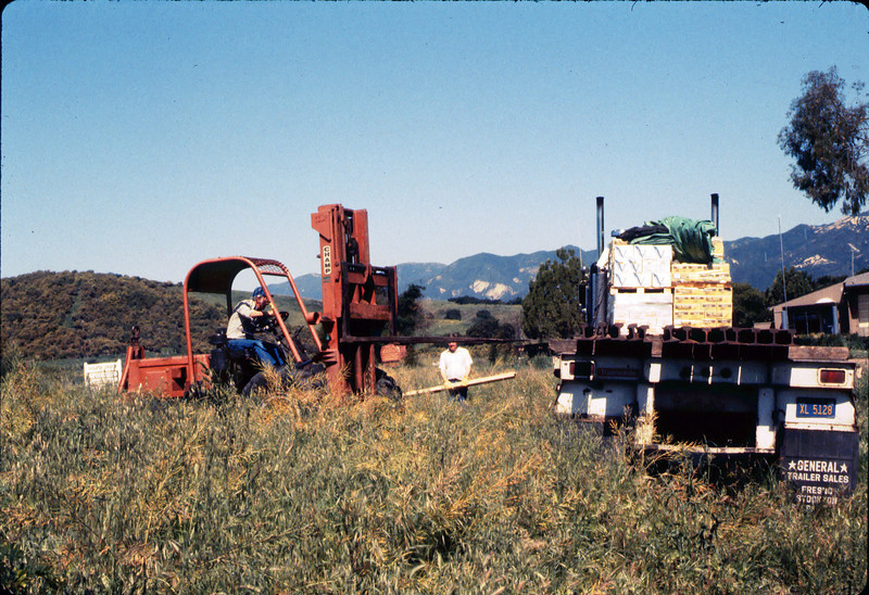 Laying of the standard-gauge track (Ed Lebeck operating forklift), 4/2/1985 acc2005.001.0476